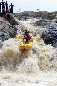 Swaziland's Great Usutu River has a wide range of white-water rapids that make it attractive to river rafters of all abilities. The high-adrenaline options like this rapid often draw spectators from the local riverbank communities who enjoy the drama and entertainment.
