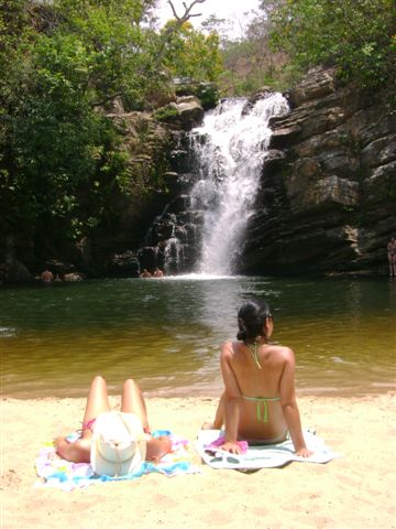 Travellers enjoy a dip at a waterfall near Pirenópolis, Brazil.