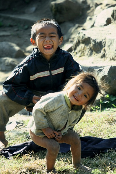 Perhaps the most common sight you'll come across when you travel through the hills of Darjeeling, India, are little people with big smiles.