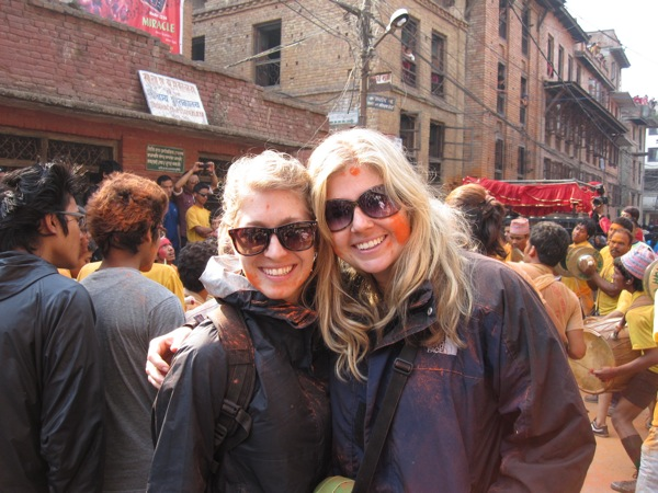 Ashley (right) and her friend Laura tinted orange at the bisket jatra celebration for the Nepalese New Year in Thimi, outside Kathmandu, Nepal