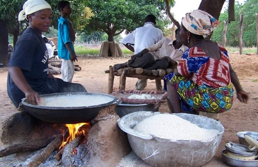 In Ghana, local women in Mognori Eco-Village fry gari, a local food made from cassava