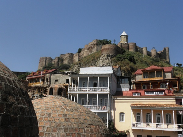 The Old Tbilisi district of Tbilisi, Georgia, is famed for its Sulphur Baths, traditional houses with wooden balconies and the Narikala Fortress towering over it