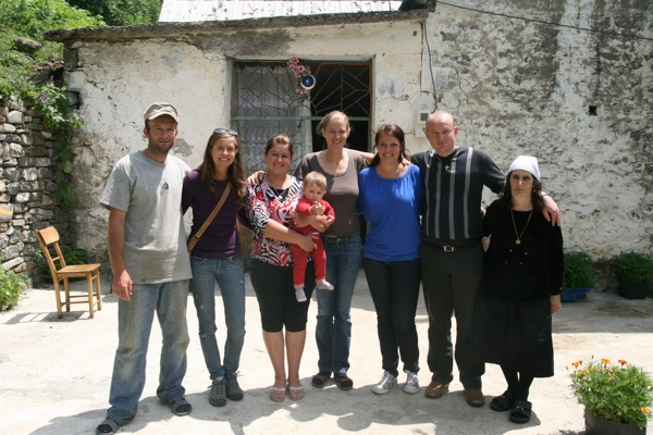 Laura (centre) and others from the Outdoor Albania team pay a visit to the family of Nacaj Guesthouse in Vermosh in the Albanian Alps