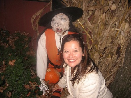 Lauren Fritsky and a scarecrow at Peddler's Village in Buck's Country, Pennsylvania