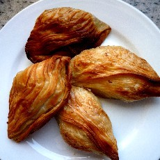 The quintessential Maltese snack, pastizzi are pastries baked with either a ricotta-cheese or mushy-pea filling.