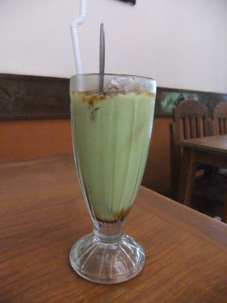 Avocado is mixed with milk and sugar, and then blended to make a bright green, creamy juice that is nice and sweet