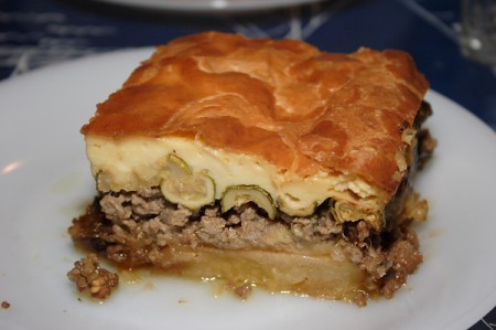Moussaka is a very popular local Greek dish composed of three layers: cooked eggplant, minced beef (but also lamb) and béchamel sauce