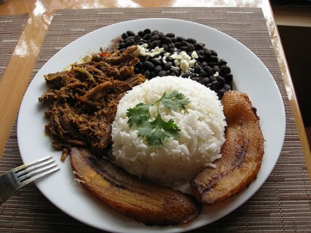Pabellón Criollo is a very colourful and delicious dish of white rice, seasoned shredded meat, black beans and fried slices of plantain