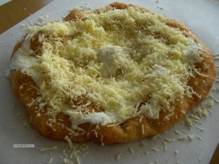 Langos is kind of Hungarian fast food that is big handful of yeast dough flattened out by hand and fried in hot oil