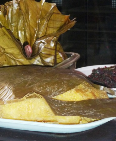 Matoke (plantain) is a cooked dish, served boiled or as a mushy, yellow mash and often accompanied by another Ugandan specialty: groundnut sauce