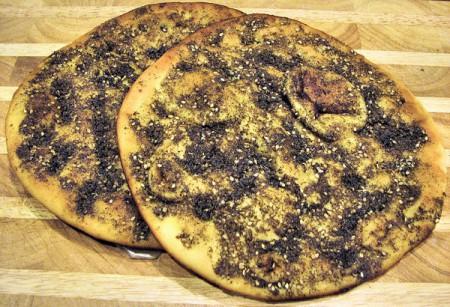 The Lebanese snack of man'oushe can be baked in a brick oven for a slightly plumper bread or rolled out thin and cooked on top of a domed griddle called a saj.