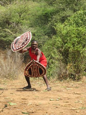 Travellers learn from Maasai community members during the Maasai Warrior Training program.