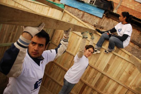 Volunteers with Un Techo Para Mi Pais in South America construct shelters