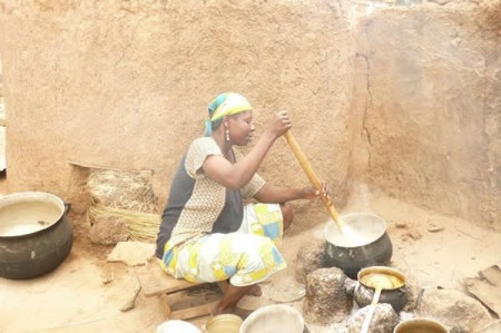 Woman in adobe home, Northern Ghana