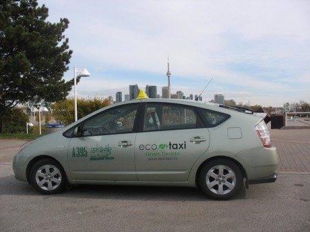 An Eco Taxi before the Toronto skyline