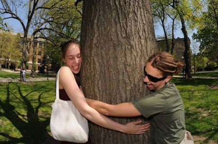Students celebrate Earth Day by hugging a tree