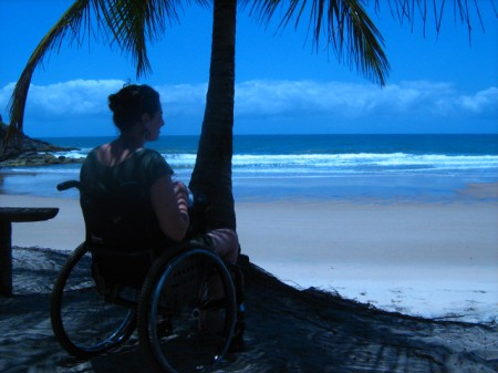 Woman in wheelchair enjoying some time on the beach.