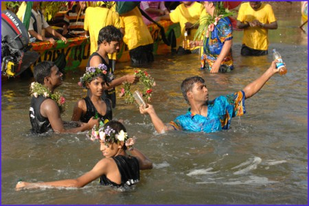 People in a river during the Sao Joao festival of Siolim, Goa, India