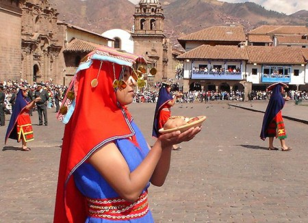 During the Intu Raymi festival in Cusco, Peru, Nustakunas (chosen women) carry offerings of fruits, potatoes and amulets. Photo courtesy of wikimedia/Cyntia Motta