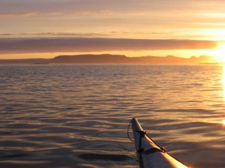 Midnight sea kayaking on Flatey. Photo courtesy of The International Ecotourism Society (TIES) and Much Better Adventures