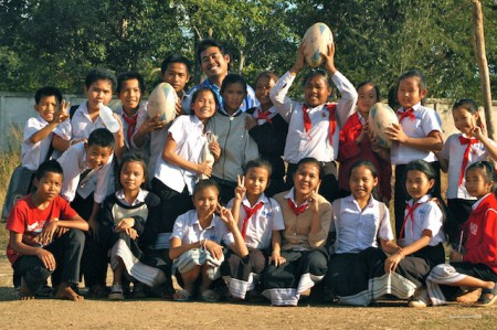 Vientiane's community rugby team gather for a group photo