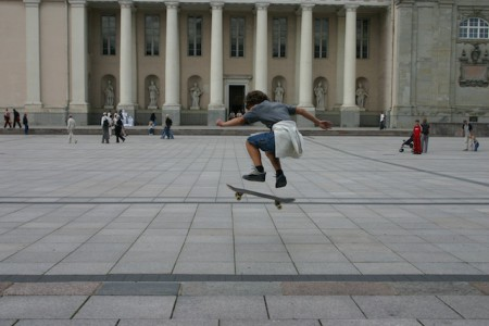 A skateboarder in front of the cathedral of Vilnius, Lithuania
