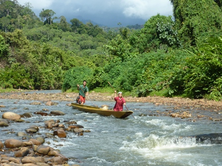 Punting down from the Penan village, Borneo