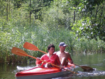 Kestas and Vilija canoeing on Ula river in Lithuania