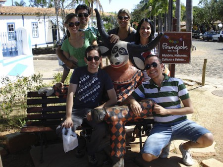 Friends gathered near a welcome sign to Pirenopolis, Brazil