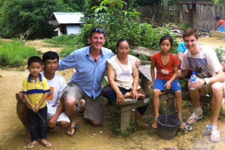 """Tip top tour leader"" Bazza & Stray Asia traveller with local friends at a village stay in Laos"