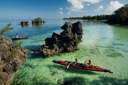 Kayakers paddle in the waters around Zanzibar