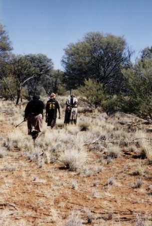 Aboriginal women in Pitantjatjara country walk the songline of Ngintaka, the giant Perentie lizard