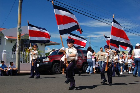 Local kids perform and wave flags in Heredia, Costa Rica
