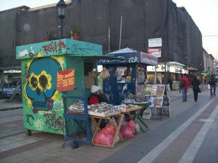 Local woman selling traditional herbs in downtown Talca, in central Chile