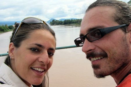 The author and a friend on the Mekong River in Laos
