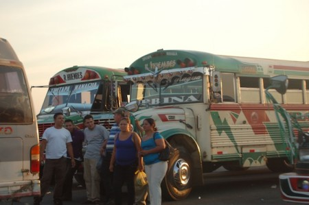 Textile workers wait for buses near Managua, Nicaragua