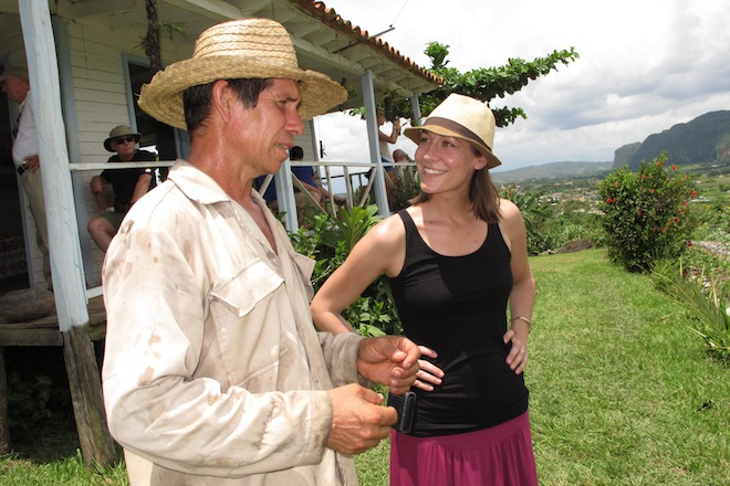 A visitor meets a local farmer in the Viñales Valley of Cuba
