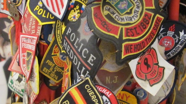 Patches from the uniforms of police and firefighters who helped after 9/11