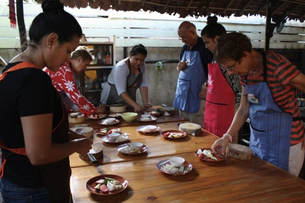 Volunteers at a Thai cooking class