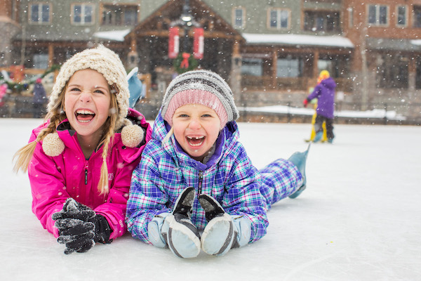 family travel and winter: Infectious smiles on kids in snow