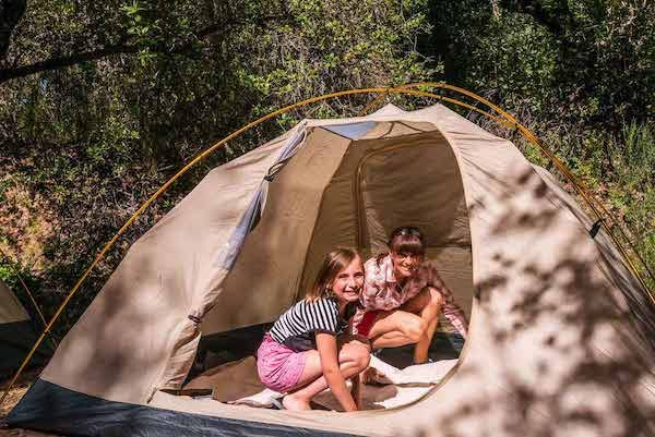 Mother and daughter work together to set up campsite