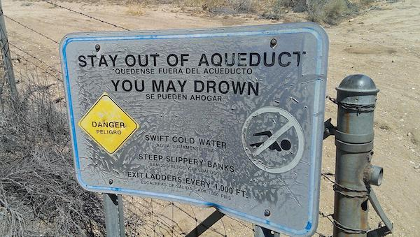 Stay out of Aqueduct sign