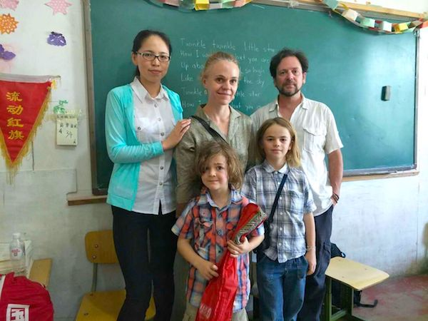 The authors and their children with the English teacher at the Chinese migrant workers' school
