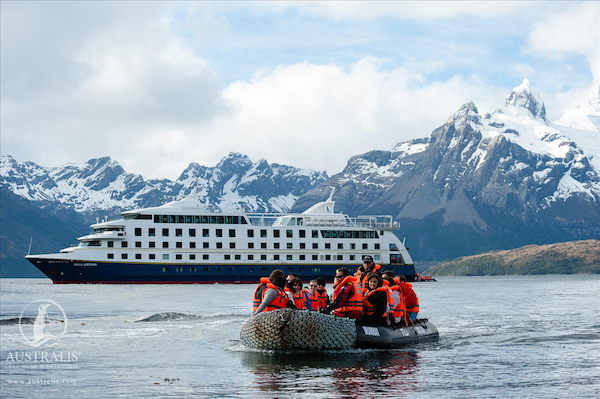 Cruisers take a zodiac to a shore excursion in remote southern South America