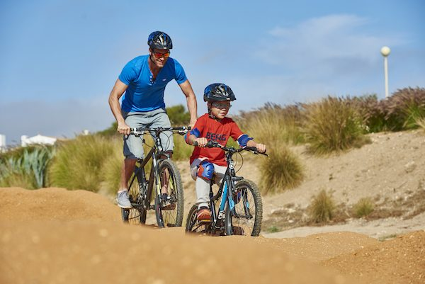Family travel by bicycle on the Sagres BMX Pump Track in Portugal