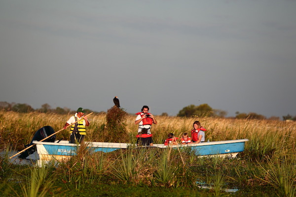 Off-the-beaten-path family travel in a boat in the Ibera Marshland of Argentina