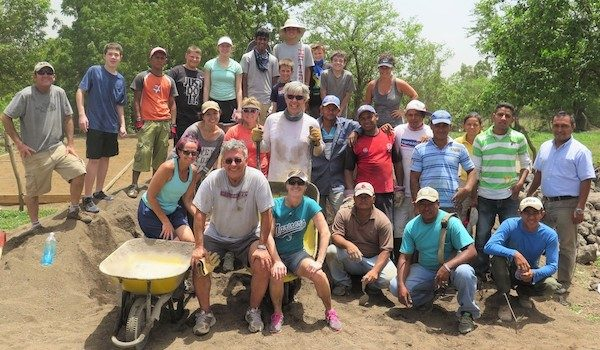 A family group takes part in a service learning project in Nicaragua