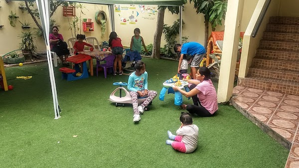 Children and parents in the play room at Aniquem, Peru's only rehabilitation center for children who are the victims of serious burns